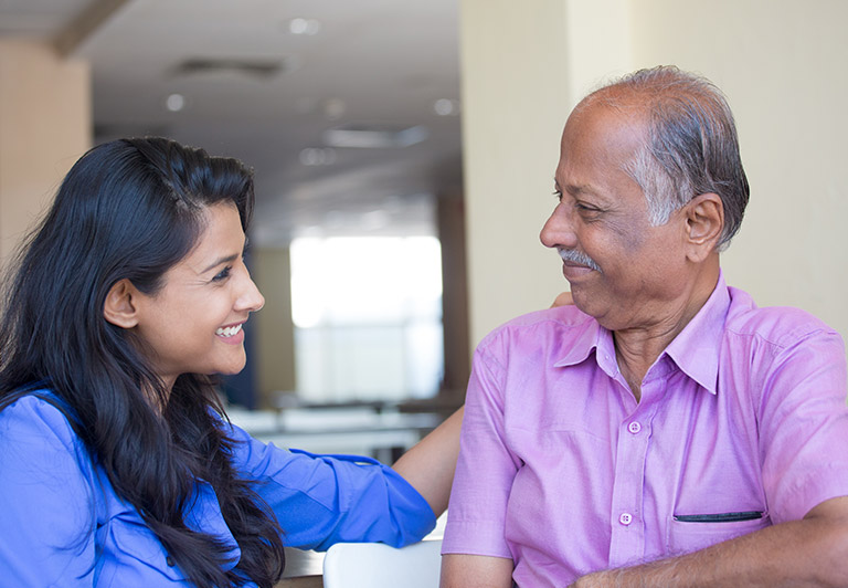 Lady Smiling With Elderly Gentleman
